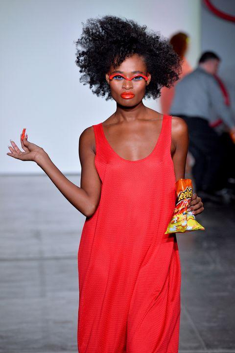 Fashion model, Fashion, Runway, Fashion show, Clothing, Red, Orange, Beauty, Fashion design, Hairstyle,