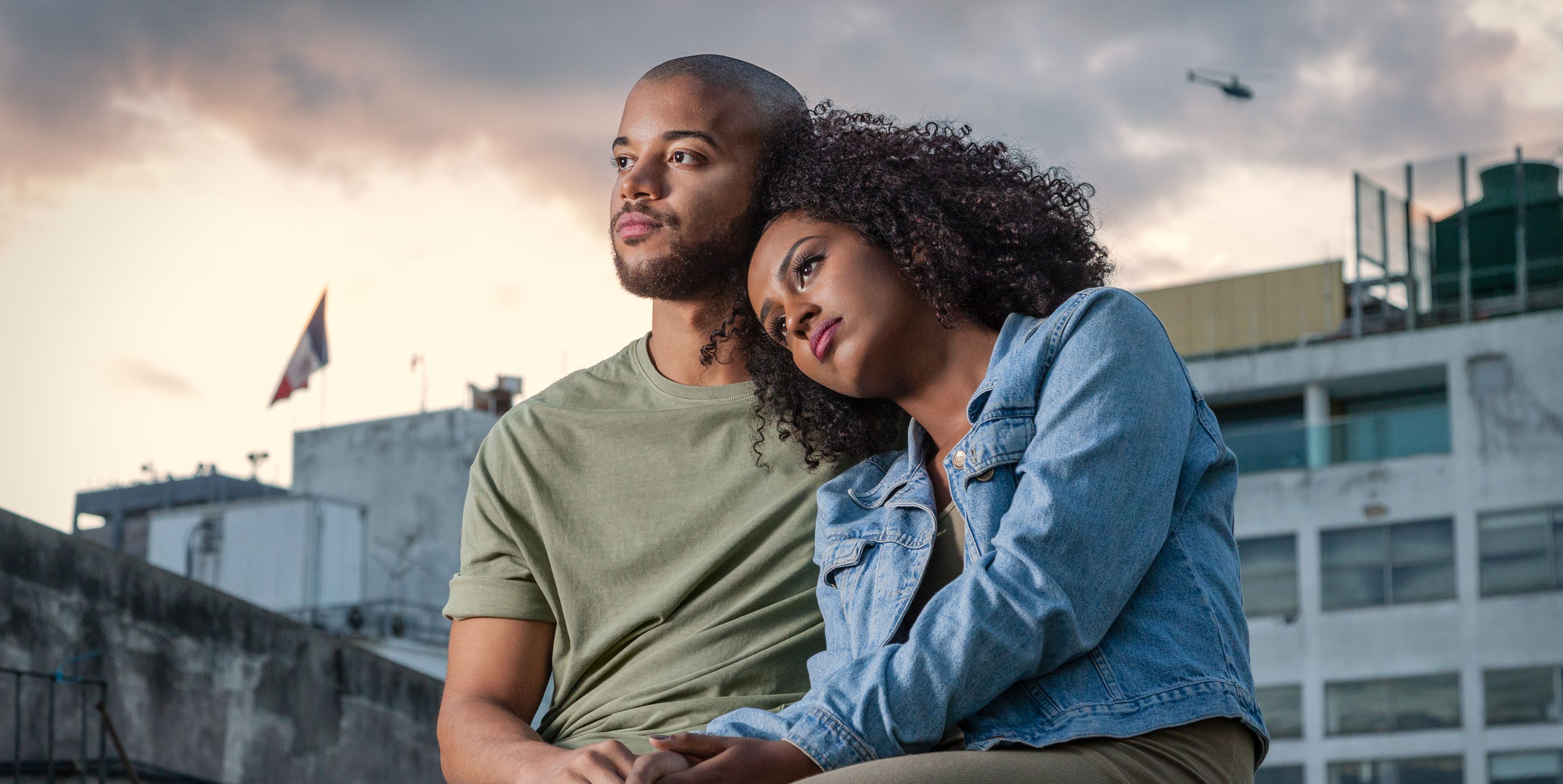 Young couple sitting on rooftop