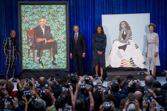 topshot   former us president barack obama and first lady michelle obama stand before their portraits and respective artists, kehinde wiley l and amy sherald r, after an unveiling at the smithsonians national portrait gallery in washington, dc, february 12, 2018 photo by saul loeb  afp  restricted to editorial use   mandatory mention of the artist upon publication   to illustrate the event as specified in the caption photo by saul loebafp via getty images