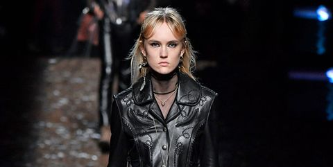 Fashion model, Fashion show, Fashion, Runway, Clothing, Public event, Leather, Event, Jacket, Outerwear,