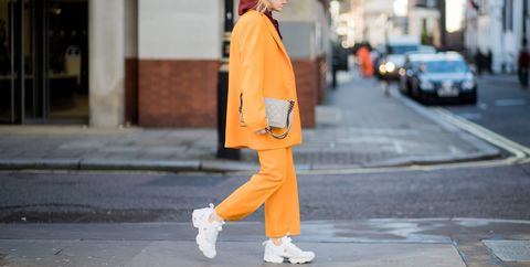 Street fashion, Photograph, Yellow, Orange, Clothing, Fashion, Snapshot, Standing, Outerwear, Coat,