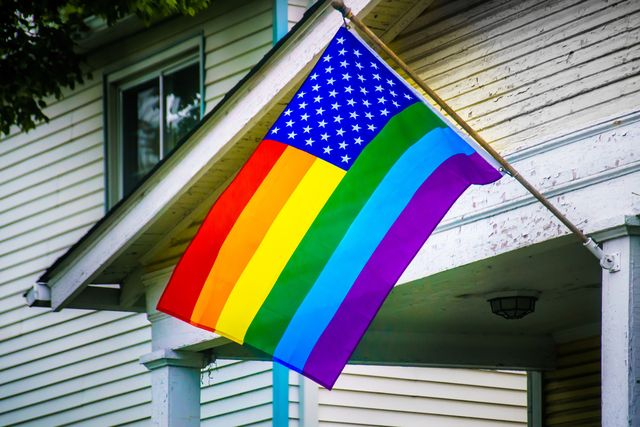 rainbow banner, displayed in in support of the lgbt lgbtq rights on a  house in columbus oh