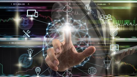 AI concept, Businessman hand touching the Polygonal brain shape of an artificial intelligence with various icon of smart city Internet of Things Technology over Cryptocurrency Bitcoin exchange trading
