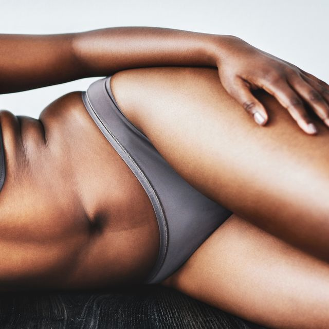 the upstanding citizen sex move studio shot of an unrecognizable woman posing against a grey background