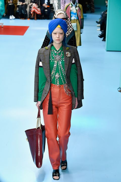 4c27c28b99a Gucci Fall 2018 Show Human Heads and Dragons - Gucci Models Carried ...