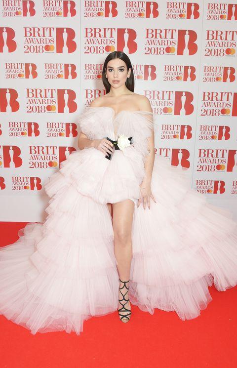 Clothing, Dress, Red carpet, Skin, Beauty, Flooring, Shoulder, Gown, Fashion model, Carpet,