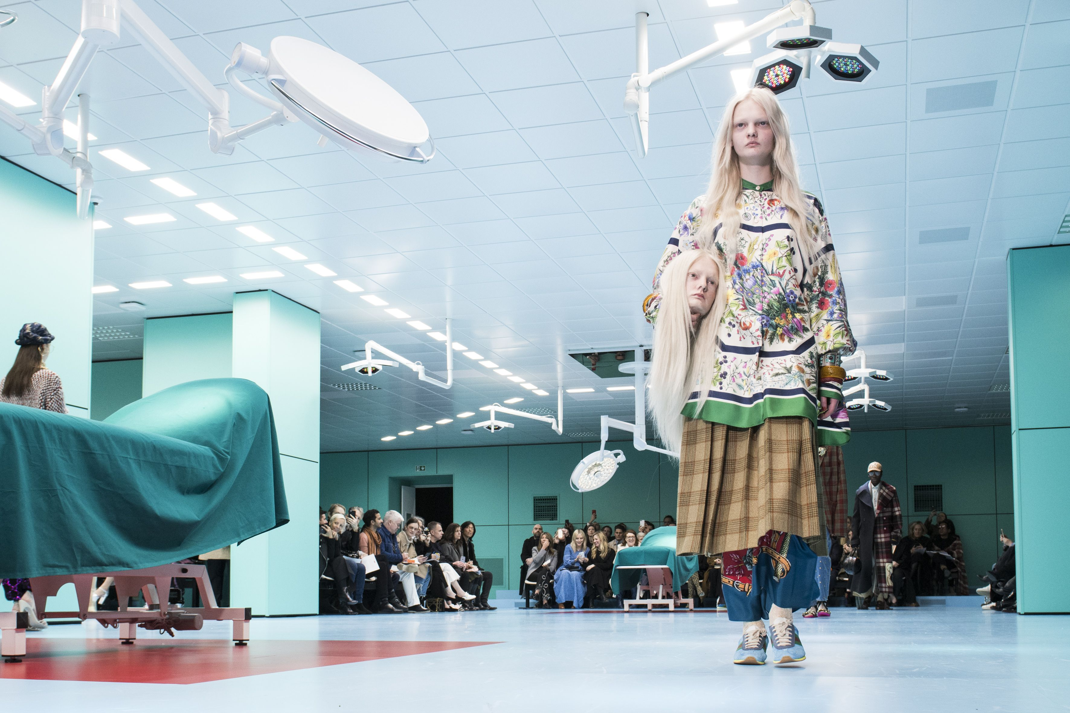 Models carried replicas of their own heads down the Gucci runway