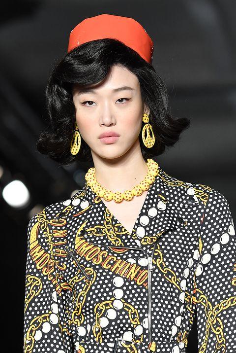 Fashion model, Fashion, Beauty, Fashion show, Street fashion, Yellow, Lip, Runway, Fashion design, Model,