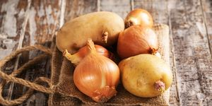 Red onion and potato on the wood background