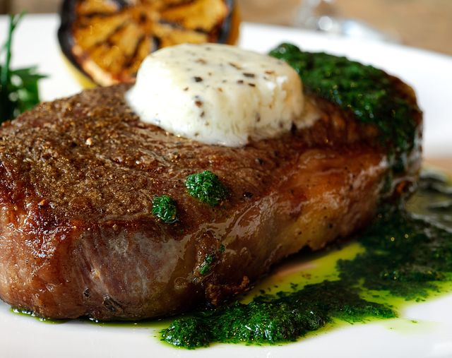fillet mignon with green herbal sauce and butter