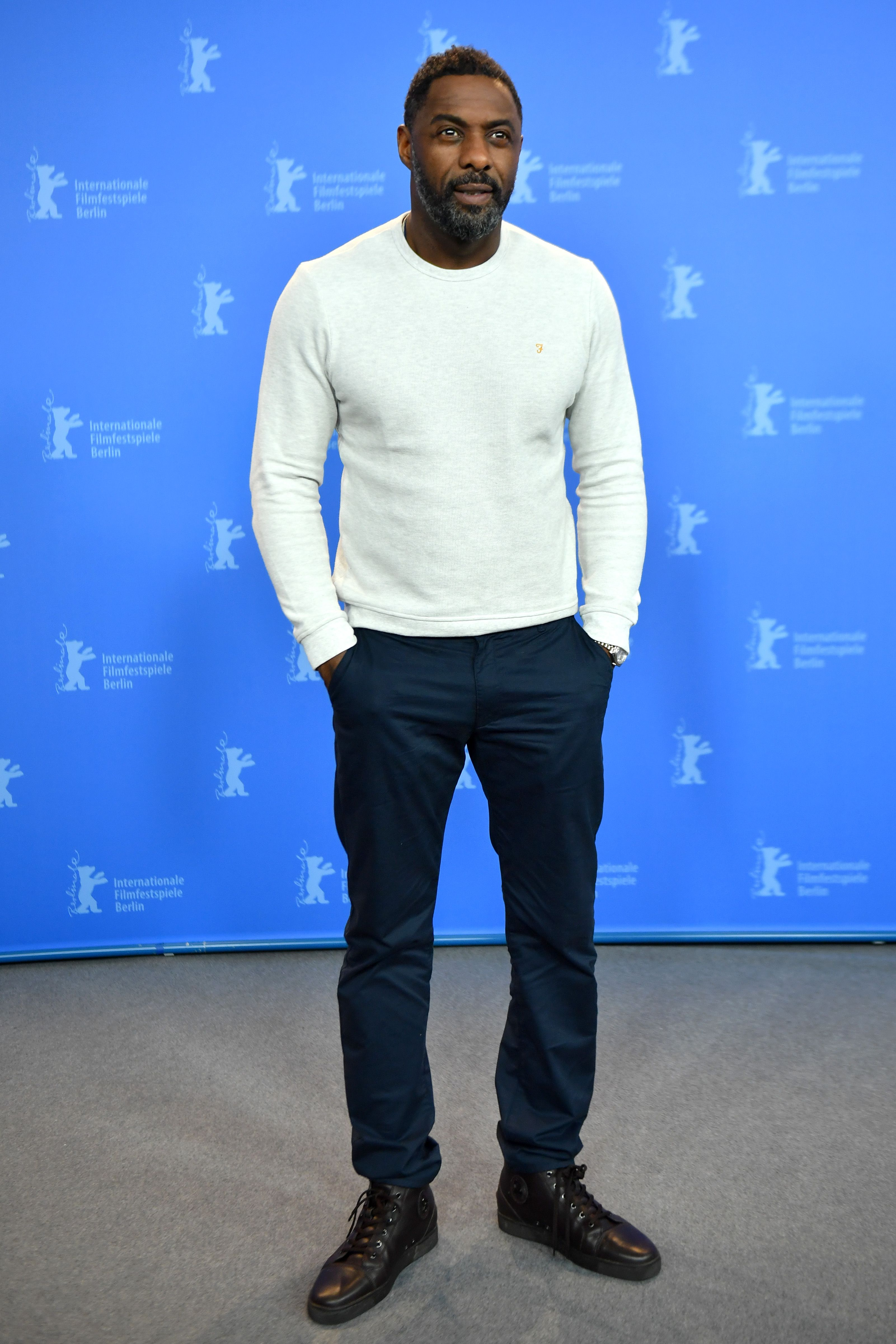 Idris Elba For the non-suit-and-tie office, maintain professionalism with a clean lightweight sweater, chinos, and boots.