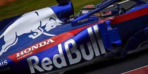 Race car, Formula libre, Formula one car, Vehicle, Blue, Motorsport, Formula one, Formula racing, Open-wheel car, Car,