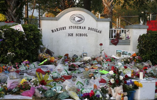 flowers, candles and mementos sit outside one of the makeshift memorials at marjory stoneman douglas high school in parkland, florida on february 27, 2018 floridas marjory stoneman douglas high school will reopen on february 28, 2018 two weeks after 17 people were killed in a shooting by former student, nikolas cruz, leaving 17 people dead and 15 injured on february 14, 2018  afp photo  rhona wise        photo credit should read rhona wiseafp via getty images