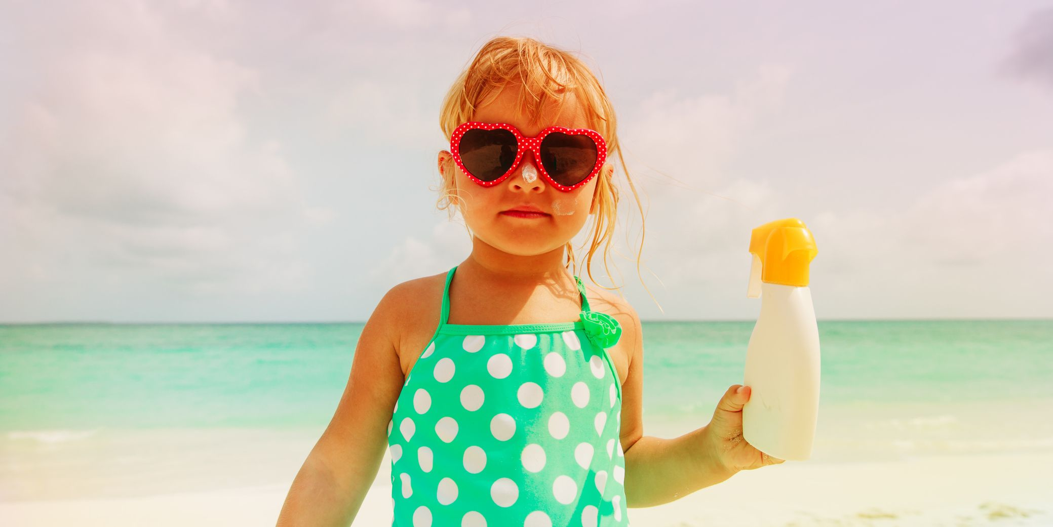 Little Girl With Sunscreen