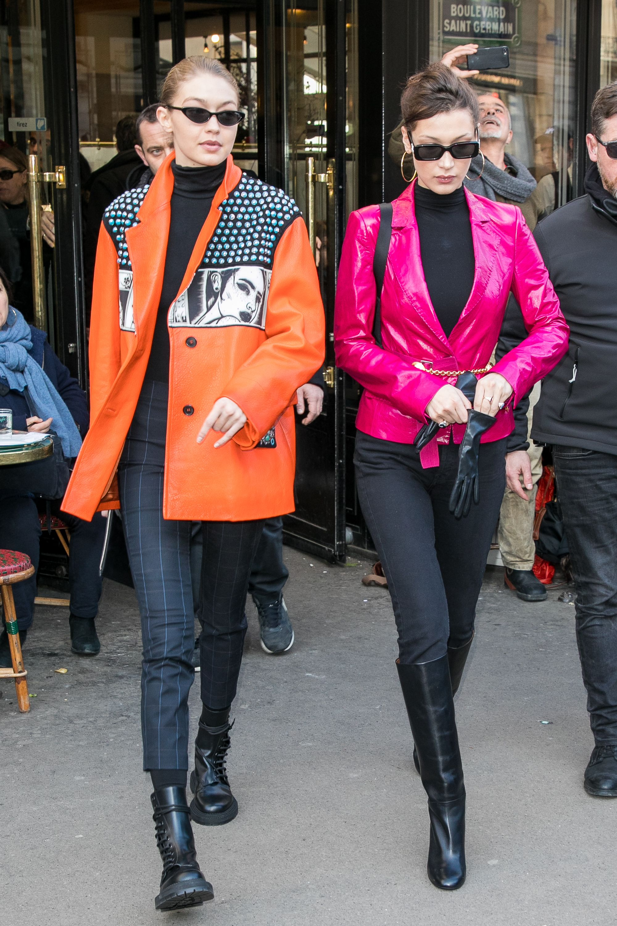 March 3, 2018 Hadid wore a pop art–inspired orange Prada leather jacket from the Spring/Summer 2018 collection while out with her sister in Paris. The pair shined in bright colors for the paparazzi.