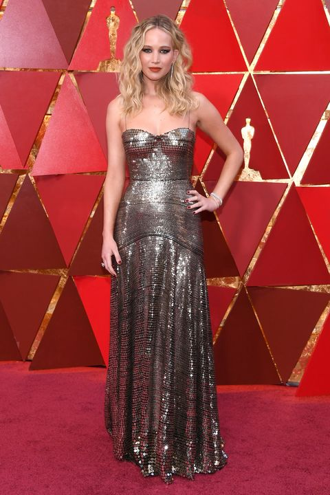 Red carpet, Dress, Carpet, Clothing, Gown, Flooring, Fashion model, Strapless dress, Premiere, Hairstyle,