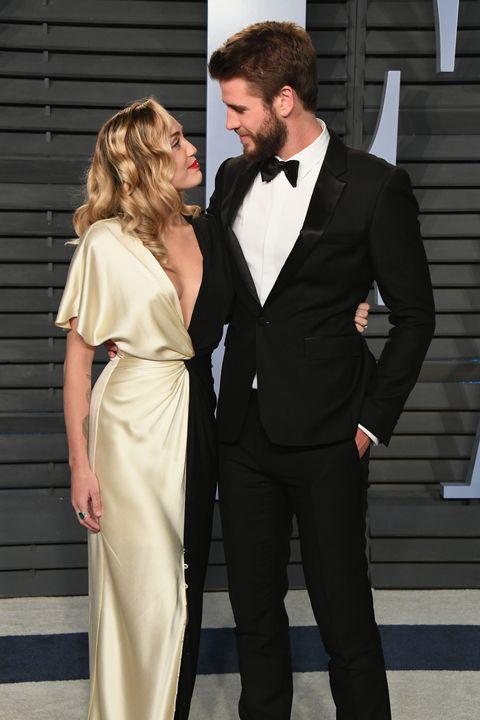 58b198286a0a28 Miley Cyrus and Liam Hemsworth at Vanity Fair Oscar Party 2018 ...
