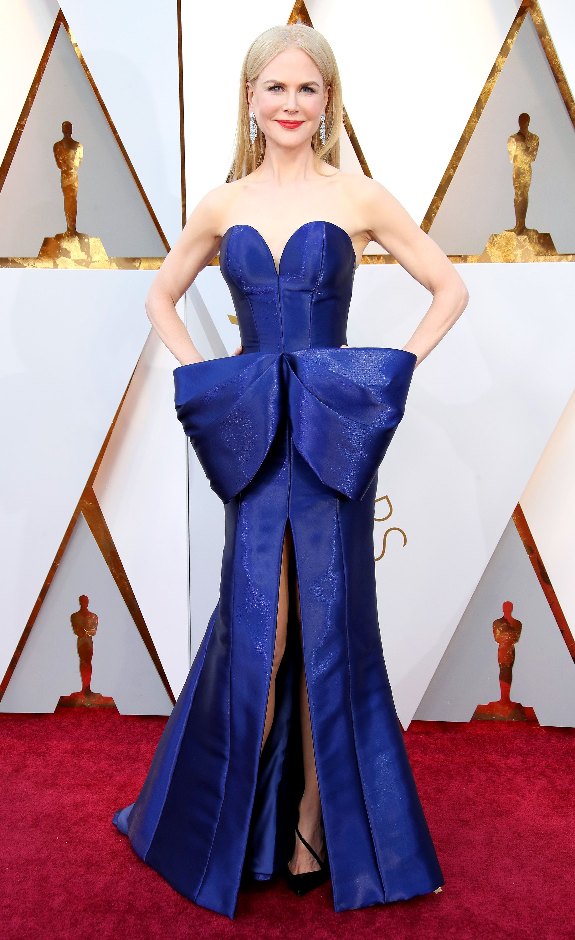 Nicole Kidman, 2018 We can't stop staring at this royal blue Armani gown—complete with a corset, bow, and slit—on Nicole Kidman at the 2018 Oscars. It perfectly complements her skin tone, too.