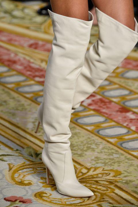 White, Footwear, Shoe, Knee-high boot, Leg, Knee, Fashion, Joint, Human leg, Yellow,