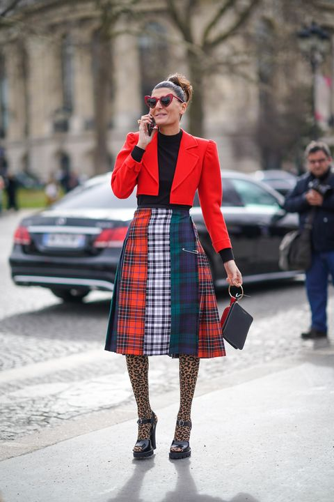 paris, france   march 06  giovanna battaglia wears a red blazer jacket, a black top, colored skirt, heart shaped sunglasses , outside chanel, during paris fashion week womenswear fallwinter 20182019, on march 6, 2018 in paris, france  photo by edward berthelotgetty images