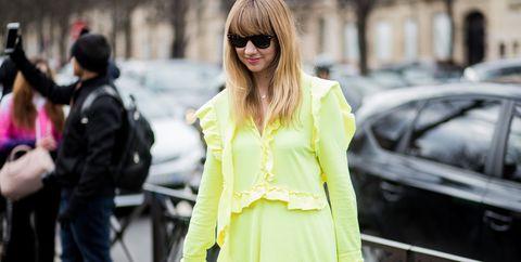 Street fashion, Clothing, Fashion, Yellow, Trench coat, Outerwear, Coat, Snapshot, Eyewear, Sunglasses,