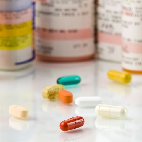 loose medicines next to medicine bottles
