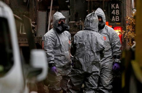 Military personnel wearing protective coveralls work to remove a vehicle as part of the ongoing investigation in connection with the major incident sparked after a man and a woman were apparently poisoned in a nerve agent attack a week ago on March 12, 2018 near Middle Winterslow. British Prime Minister Theresa May chaired a meeting of her national security team after weekend confirmation that traces of a nerve agent used in the attempted murder of former Russian spy Sergei Skripal, and his daughter Yulia, were found in a pub and a restaurant they visited.