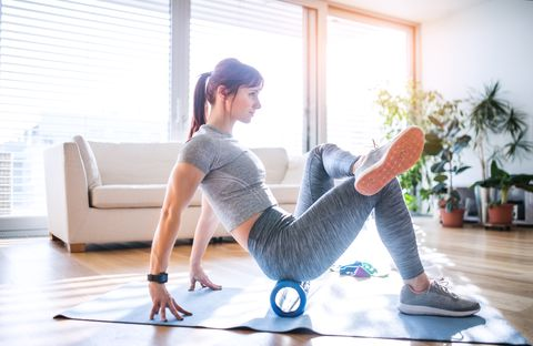 beautiful young woman doing exercise at home