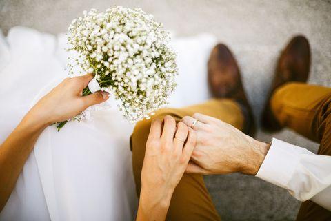 Photograph, Marriage, Bouquet, Yellow, Flower, Hand, Ceremony, Bride, Dress, Wedding dress,