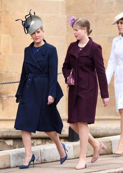 Clothing, Fashion, Coat, Trench coat, Overcoat, Standing, Street fashion, Outerwear, Footwear, Headgear,