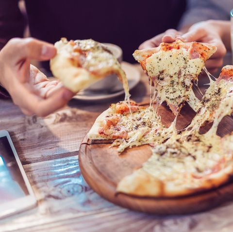 eating food close up of people hands taking slices of pizza group of friends sharing pizza together