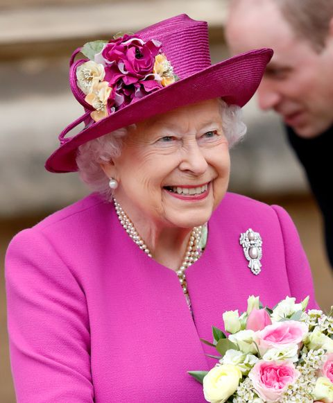 Pink, Facial expression, Hat, Purple, Smile, Magenta, Fashion accessory, Flower, Headgear, Tradition,