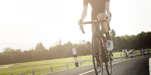 Asian Healthy Cyclist Wearing Helmet Cycling And Exercise On Bicycle In Sprint Track Open