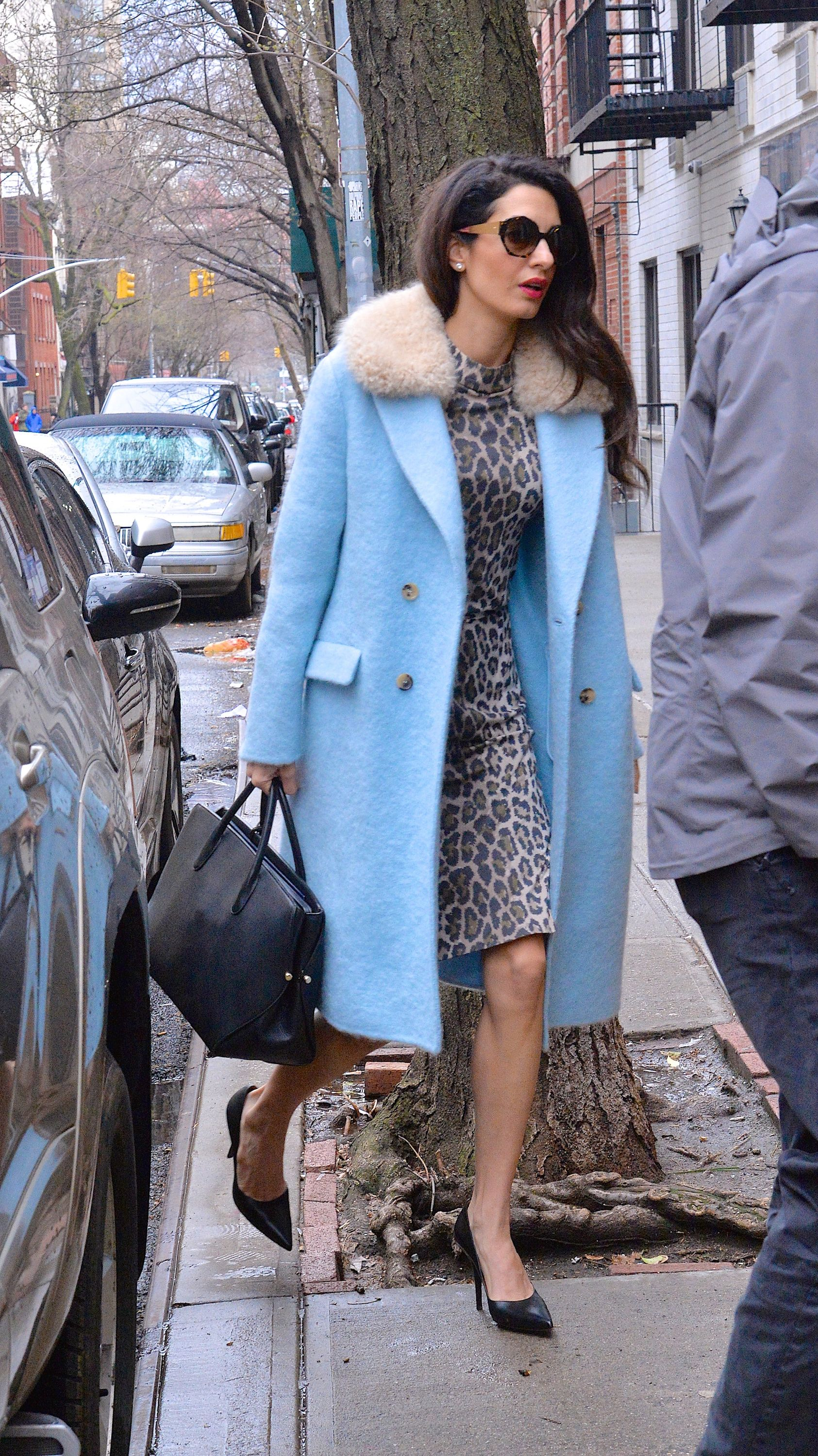 April 6, 2018 In a powder blue coat and cheetah dress while walking around New York City.