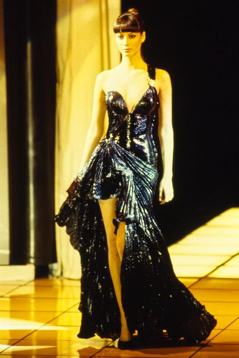 model walks versace rtw fall 1994 runway collection  local caption