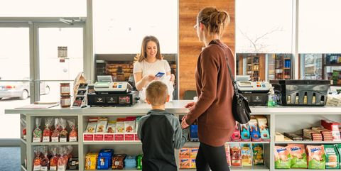 Mother with son shopping in a delicatessen store