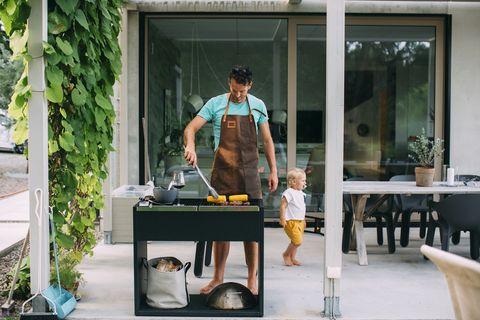 Man barbecuing in garden