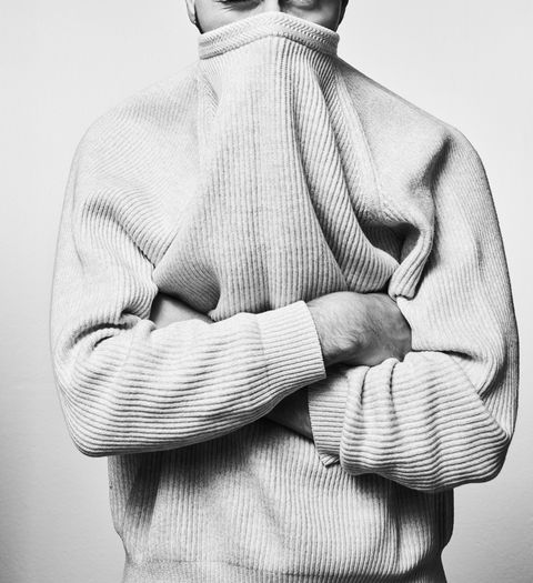 Man with jumper covering face