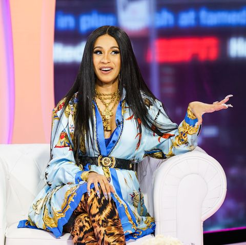 Fashion, Beauty, Yellow, Performance, Event, Black hair, Fashion design, Long hair, Model, Fashion accessory,