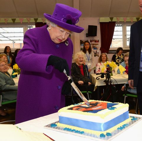 britains queen elizabeth ii cuts a cake during a visit to the king george vi day centre in windsor, west of london on april 12, 2018 to mark the 60th anniversary of the centres opening and the 70th anniversary of the windsor old peoples welfare association   the centre operates as a lunch and social club, providing a safe and friendly environment for older windsor residents members are encouraged to maintain their independence and wellbeing through activities and social interaction photo by eamonn m mccormack  pool  afp        photo credit should read eamonn m mccormackafp via getty images