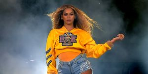 beyonce on stage coachella yellow jumper nails