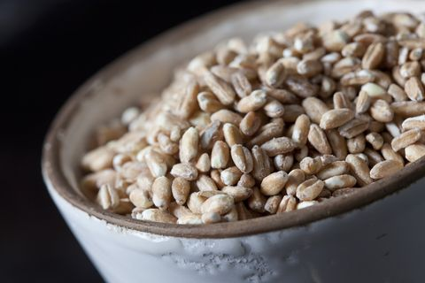Bowl of spelt grains, close-up