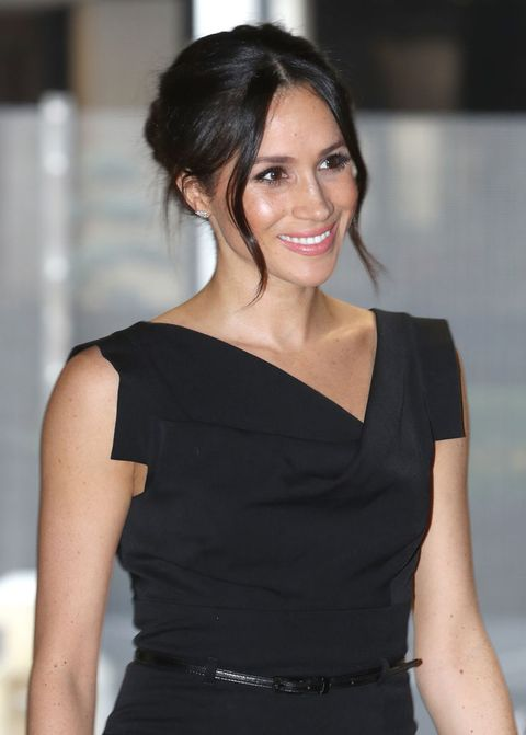 meghan markle stepped out in stunning black dress for women s empowerment reception meghan markle stepped out in stunning