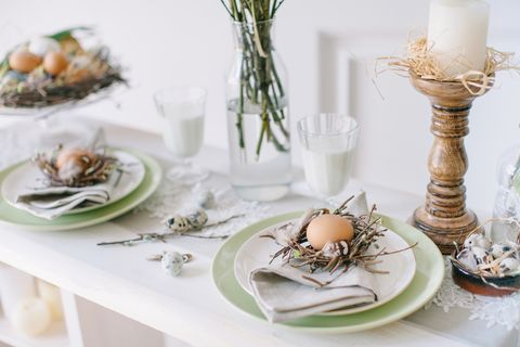 easter eggs in plate on table elle decor
