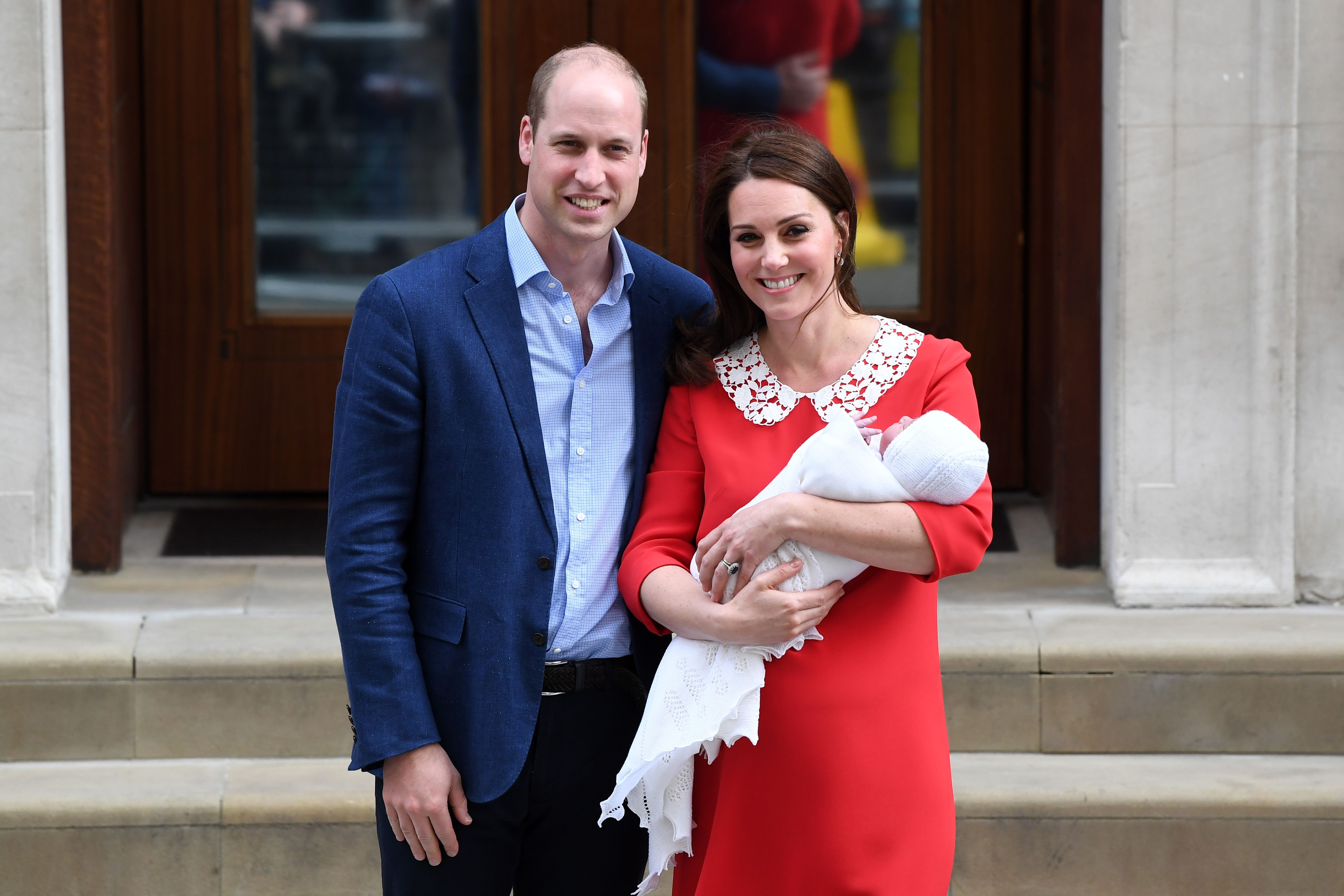 f719900c07955 Kate Middleton Is Glowing in a Simple Red Dress as She Leaves the Hospital  After Giving Birth