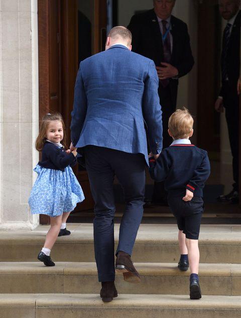 Standing, Suit, Leg, Formal wear, Interaction, Footwear, Gesture, Outerwear, Shoe, Electric blue,