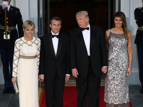 Red carpet, Formal wear, Suit, Carpet, Dress, Event, Fashion, Tuxedo, Gown, Flooring,