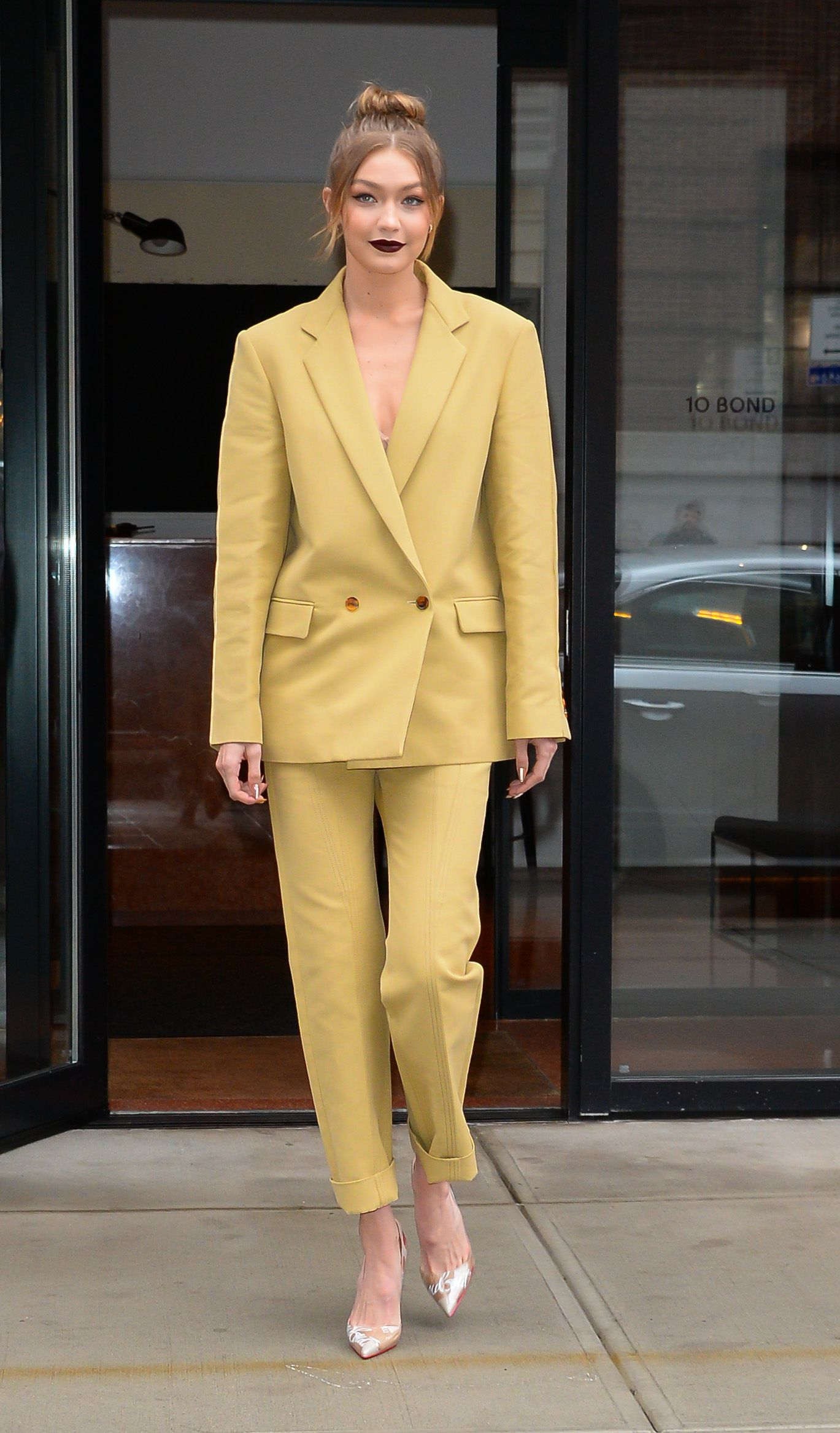 April 25, 2018 The model attended the NYC premiere of Being Serena in a mustard-colored Derek Lam suit. She wore Effy gold pave hoop earrings, Christian Louboutin pumps, and added a dark-colored lip for moody vibes.