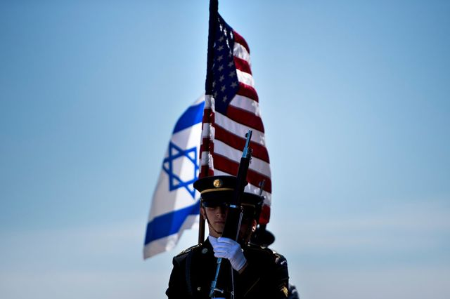 members of the us military carry the flags of israel and the united states before the arrival of israels minister of defense avigdor lieberman during an honor cordon at the pentagon on april 26, 2018 in washington, dc photo by brendan smialowski  afp        photo credit should read brendan smialowskiafp via getty images