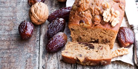 Homemade  date and walnut loaf cake on old wooden table